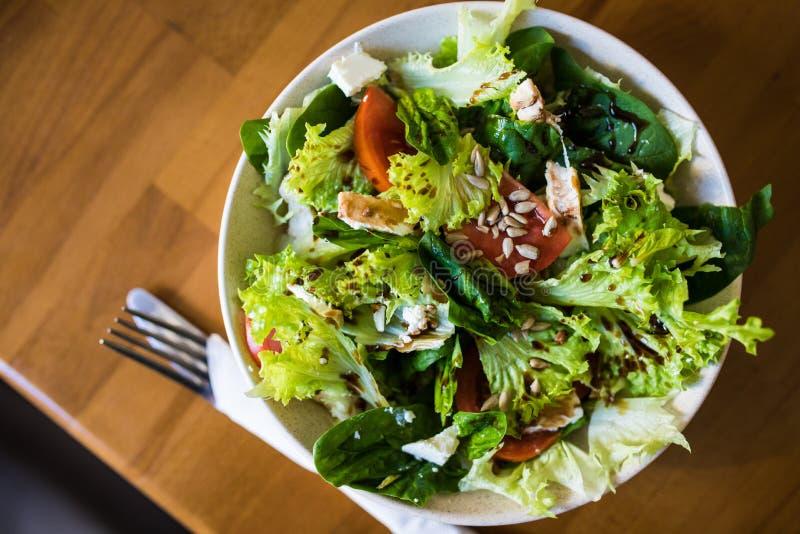 Healthy vegetable fresh salad on plate. Diet menu. Top view royalty free stock image