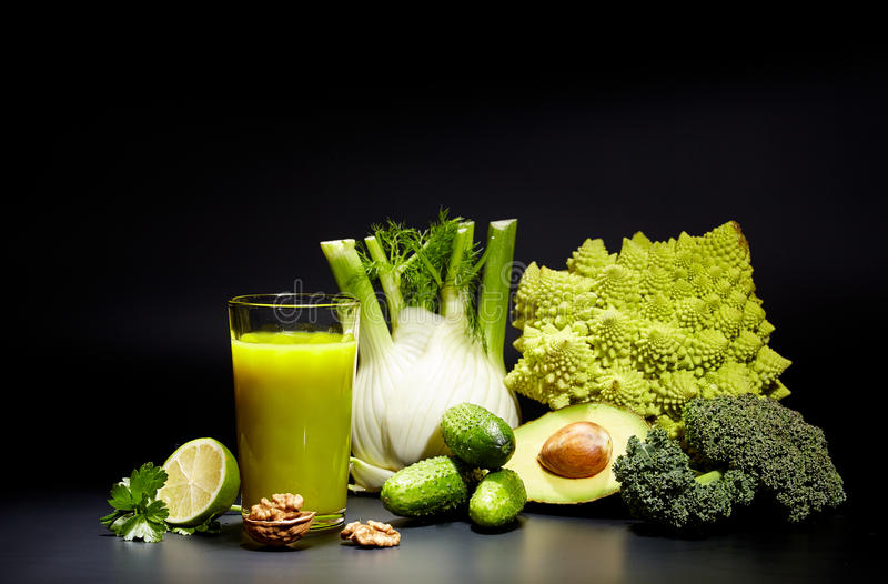 Healthy vegetable juices for refreshment. And as an antioxidant . Black background stock image