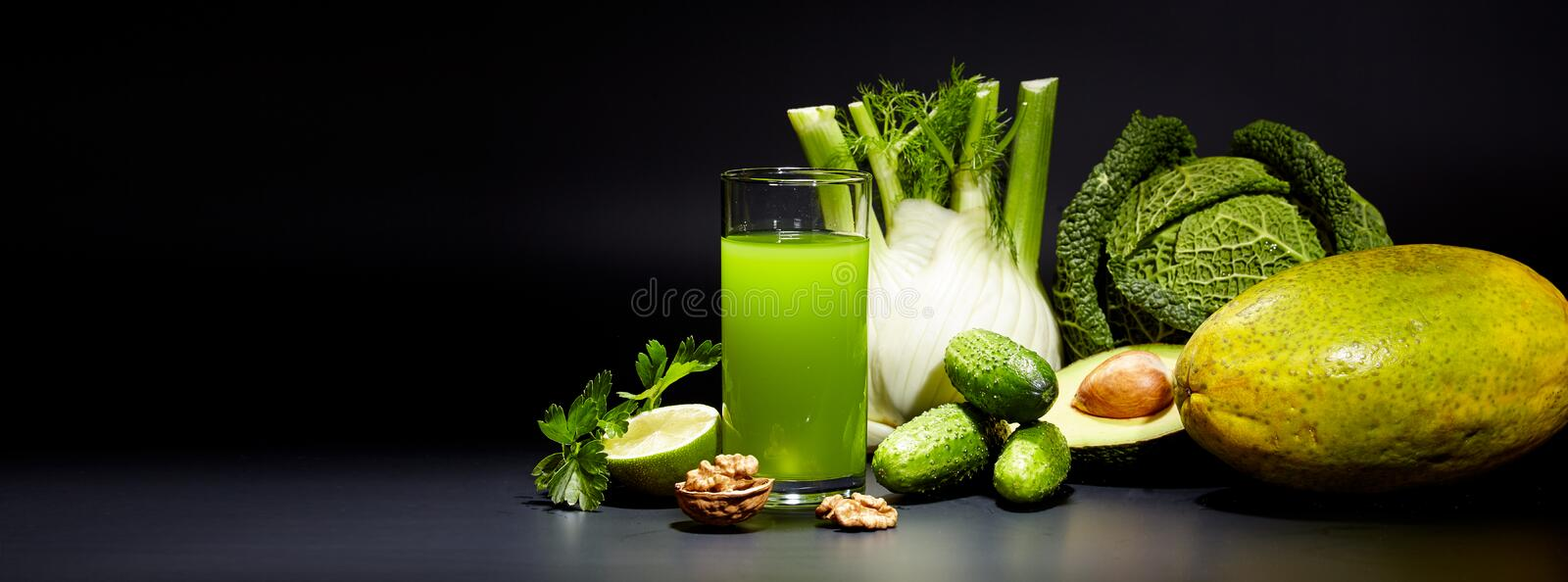 Healthy vegetable juices for refreshment. And as an antioxidant . Black background royalty free stock photos