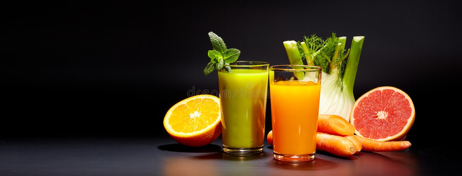 Healthy vegetable juices for refreshment. And as an antioxidant . Black background stock photography