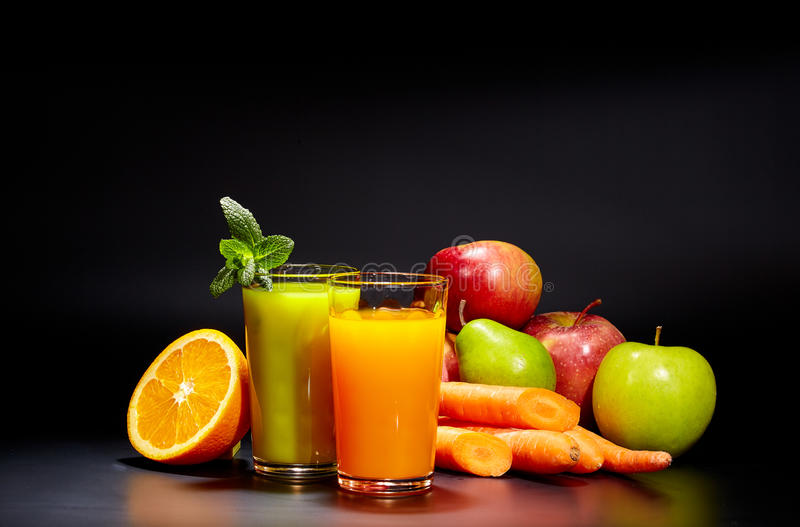 Healthy vegetable juices for refreshment. And as an antioxidant . Black background royalty free stock image