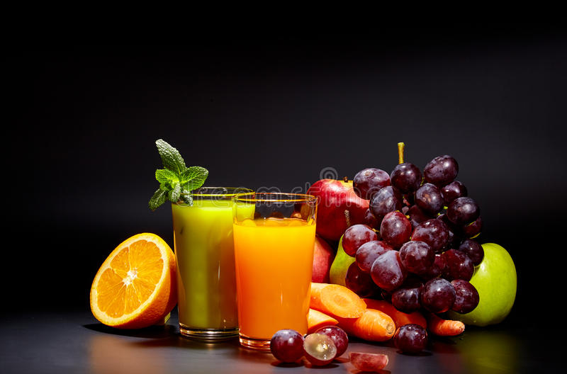 Healthy vegetable juices for refreshment. And as an antioxidant . Black background stock photo