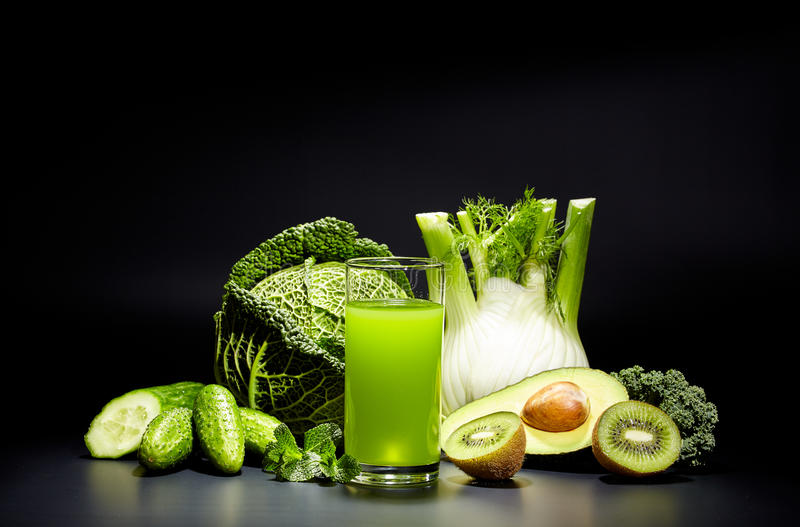 Healthy vegetable juices for refreshment. And as an antioxidant . Black background royalty free stock images