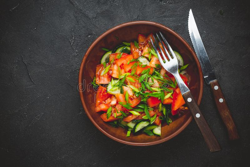 Healthy vegetable salad of fresh tomato, cucumber, onion, spinach, lettuce stock photo