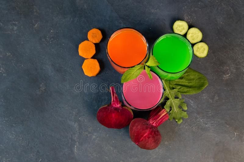 Healthy vegetable smoothie and juice on grey backround stock photography