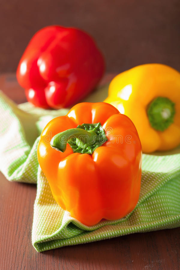 Healthy vegetables colorful peppers on rustic background royalty free stock photos