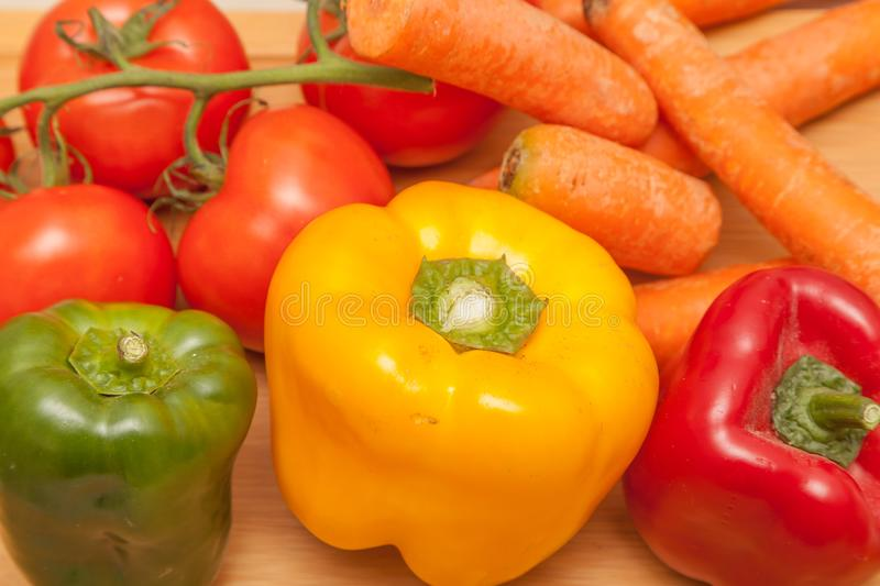 Healthy vegetables - pepper, carrot and tomatoes. Healthy vegetables - close up of pepper, carrot and tomatoes royalty free stock images