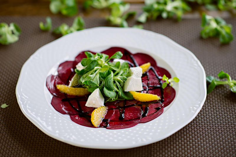 Healthy Vegetarian Beetroot and Orange Salad with Goat Cheese stock photography