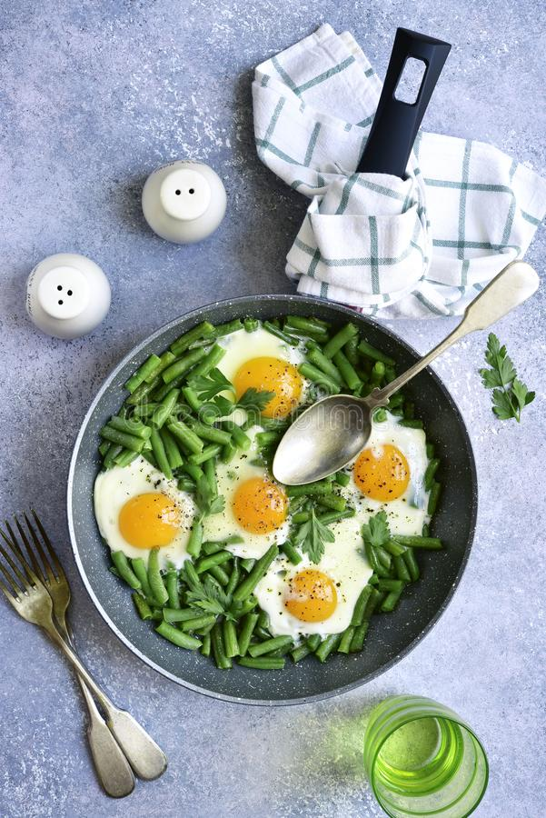 Healthy vegetarian breakfast : fried eggs and asparagus bean in stock images