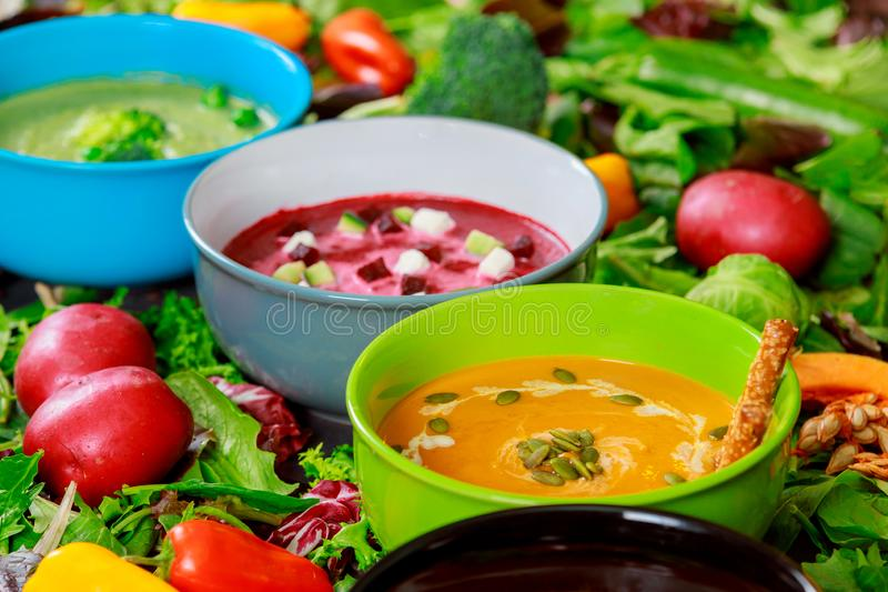 Variety of colorful tasty vegetables cream soups and fresh ingredients for soups. Healthy food vegetarian food royalty free stock photos