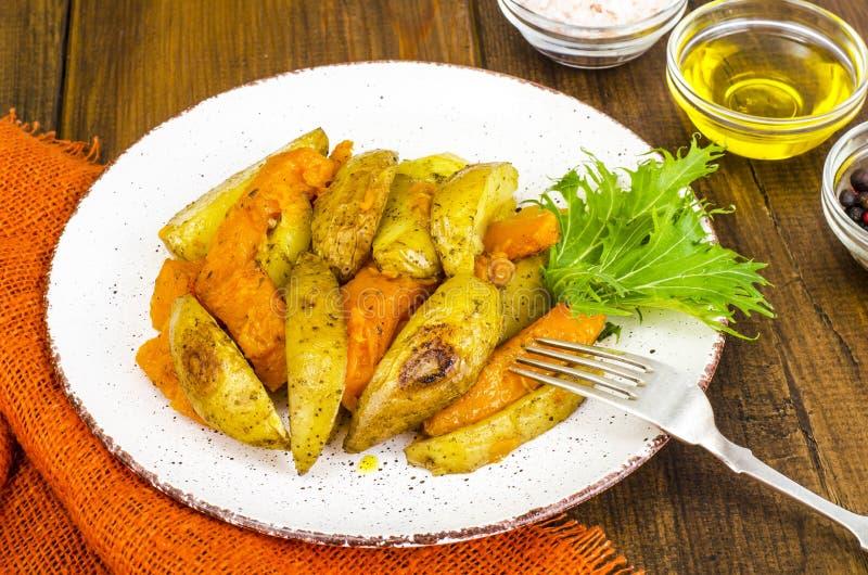 Healthy vegetarian diet food, baked vegetables, pumpkin and potatoes stock photos