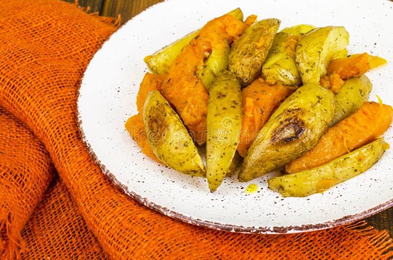 Healthy vegetarian diet food, baked vegetables, pumpkin and potatoes stock photo