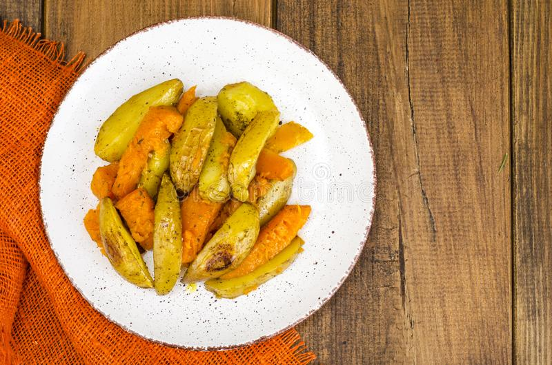 Healthy vegetarian diet food, baked vegetables, pumpkin and potatoes stock image