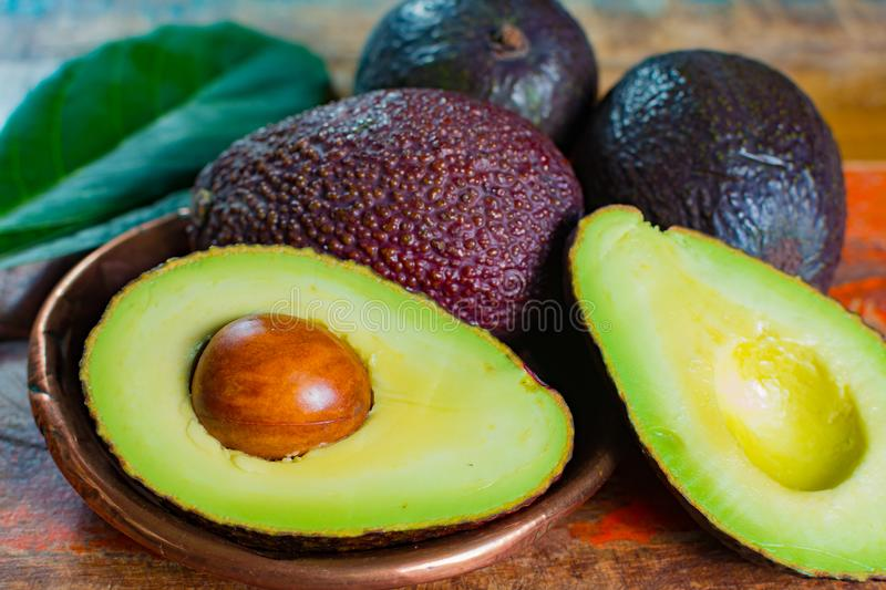Healthy vegetarian food – green ripe avocado, new harvest, wit royalty free stock photos