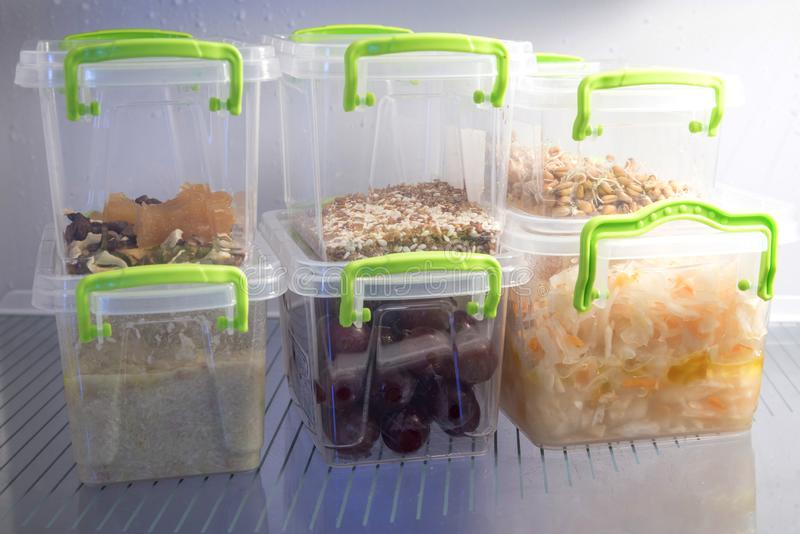 Healthy vegetarian food divided into portions and folded into plastic containers in the refrigerator stock photos