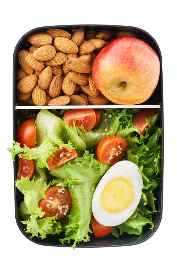 Healthy vegetarian lunch box with salad, nuts and apple. Isolate royalty free stock photography