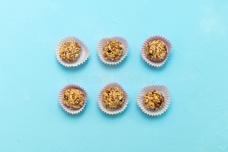Healthy vegetarian raw bites energy balls made of dried fruits and nuts and seeds stock images