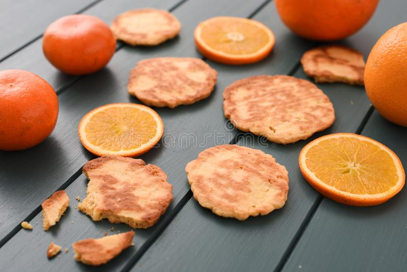 Healthy vegetarian snack. Homemade cookies, clementines and oran stock photos