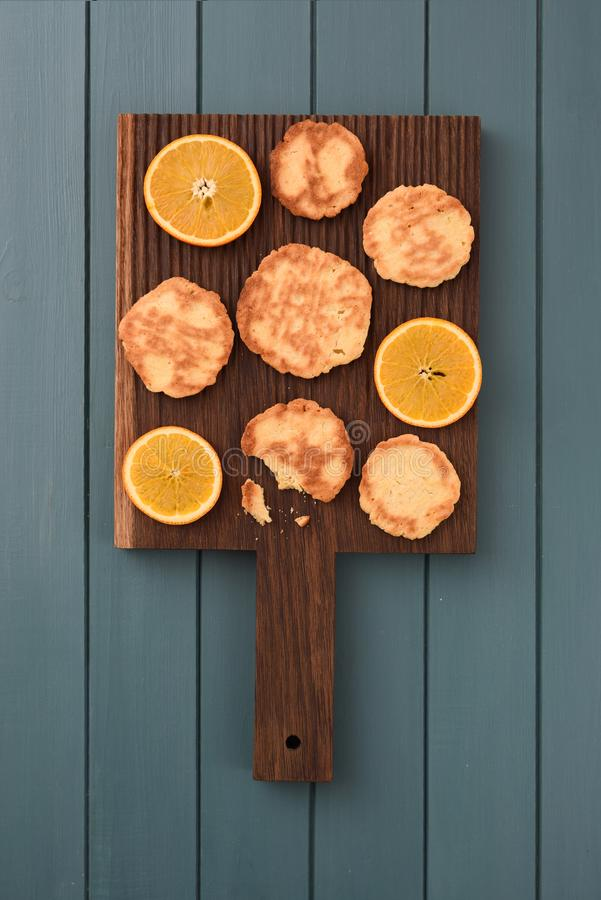 Healthy vegetarian snack. Homemade cookies and orange slices on stock image