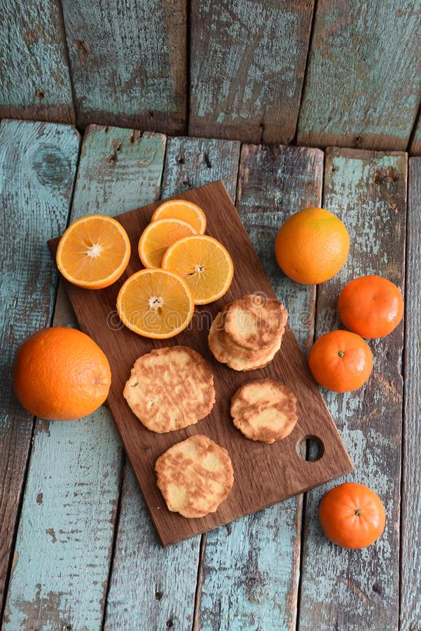 Healthy vegetarian snack. Homemade cookies, raw clementines and royalty free stock photography