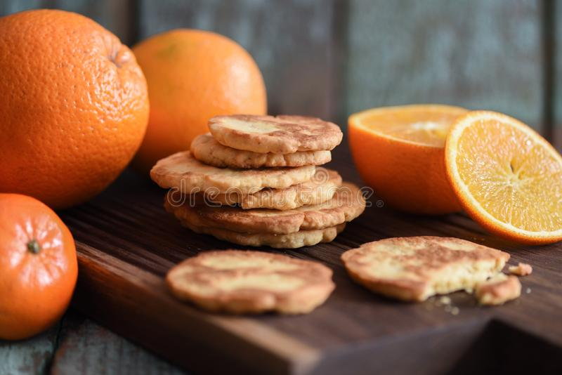 Healthy vegetarian snack. Homemade cookies and raw oranges on da stock images