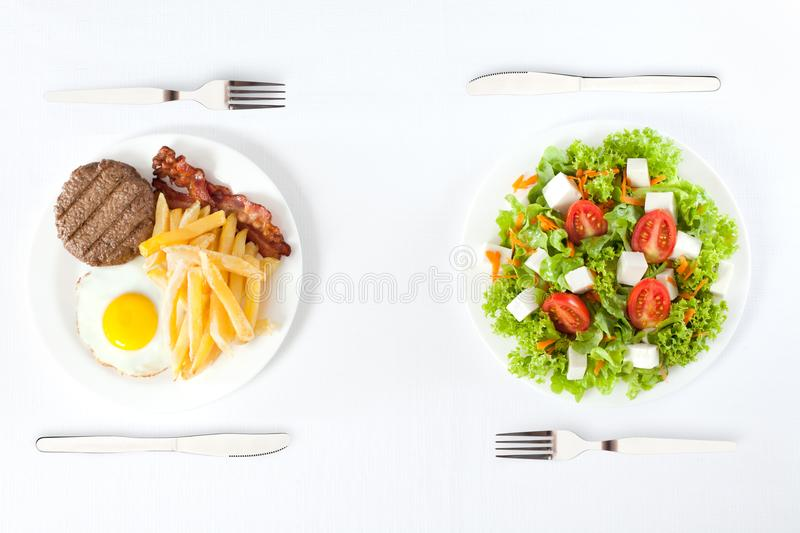 Healthy versus junk food stock photo