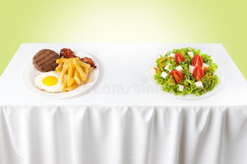 Healthy versus junk food royalty free stock photography