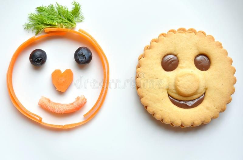 Healthy versus unhealthy food concept. With a pasty and vegetable and fruit choice. funny food concept royalty free stock photo