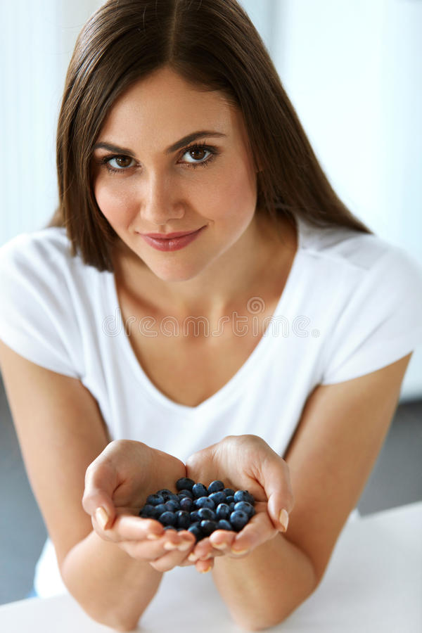 Healthy Vitamin Food. Beautiful Smiling Woman With Blueberries royalty free stock photos