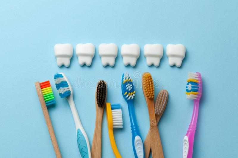 Healthy white teeth on blue background with toothbrush.  royalty free stock photos