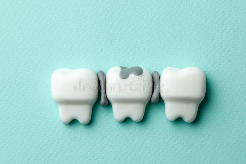 Healthy white teeth and tooth with caries on green mint background. Healthy white teeth and tooth with caries on green mint background stock images