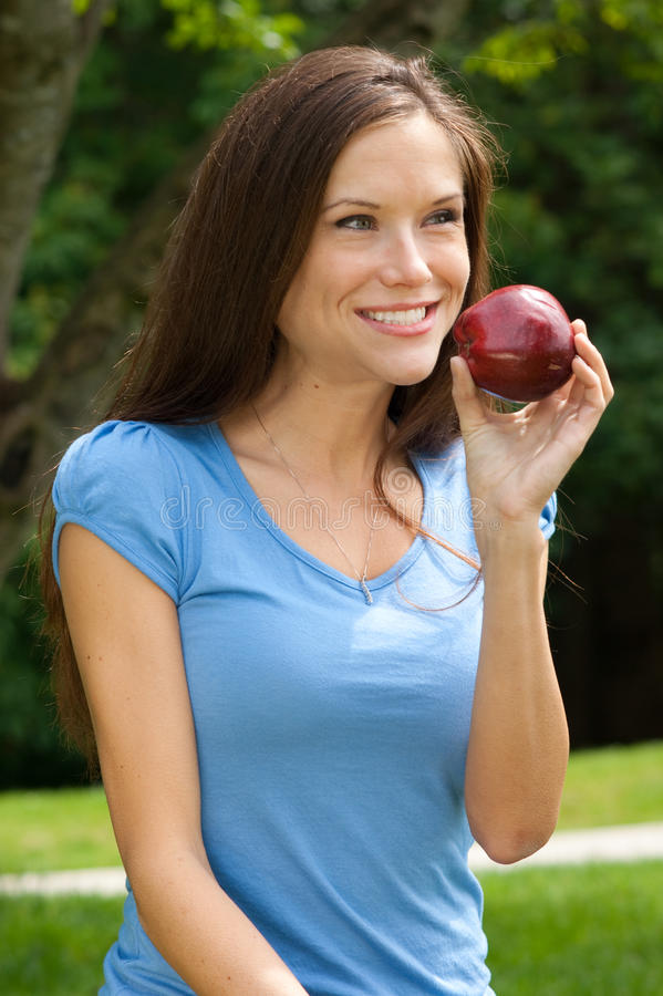 Healthy Woman Outside Holding Red Delicous Apple stock images