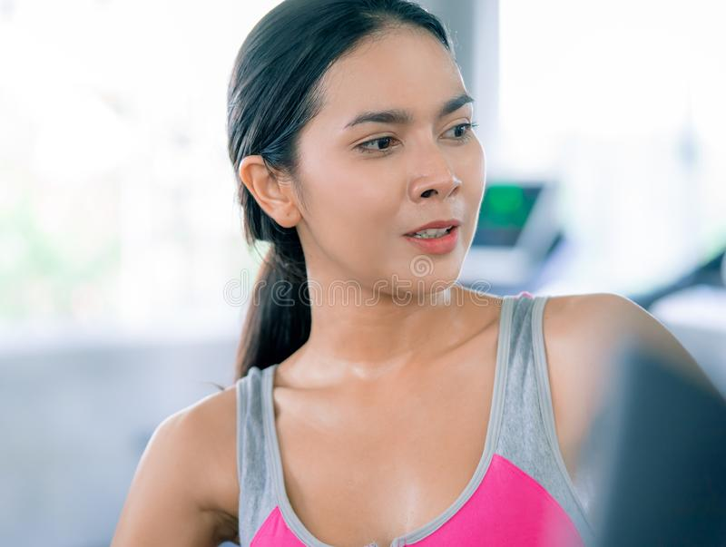 Healthy Woman body sweating while they exercising in Fitness Gym stock photo