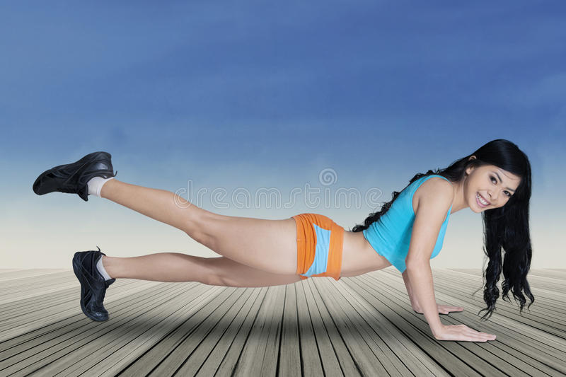 Healthy woman doing push up royalty free stock image