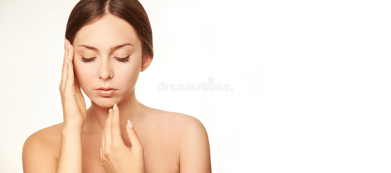 Healthy woman face. Young girl hand concept. Lotion cosmetics stock image