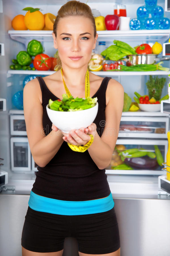 Healthy woman with fresh salad royalty free stock photography