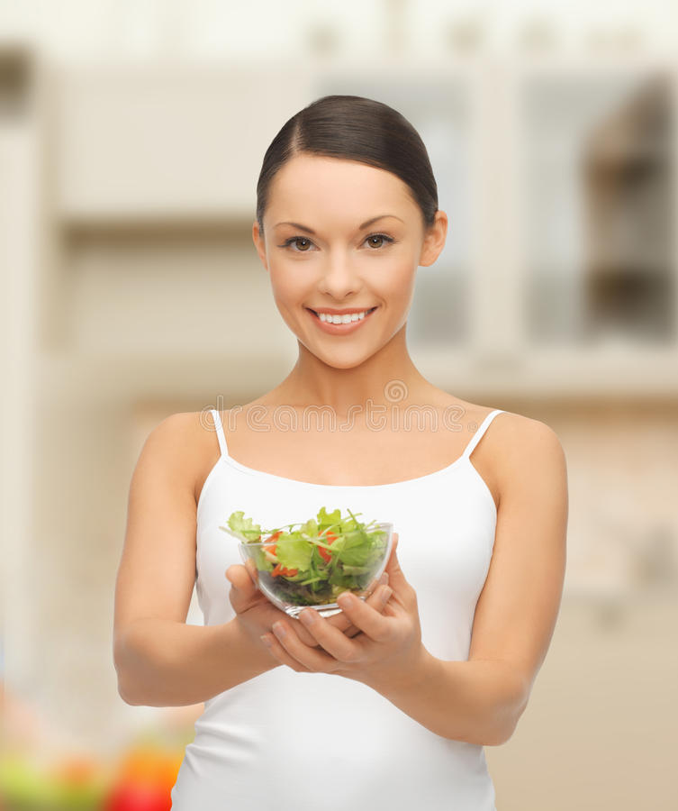 Download Healthy Woman Holding Bowl With Salad In Kitchen Stock Photo - Image: 37149362