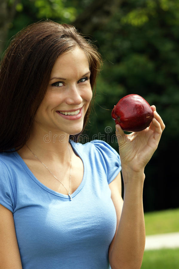 Healthy Woman Smiling Holds Red Apple Fruit Food royalty free stock photos
