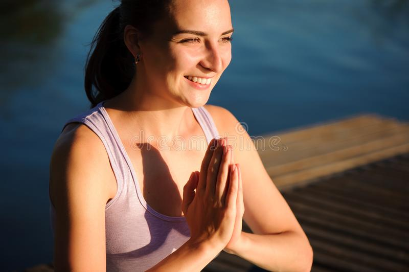 Healthy woman lifestyle balanced practicing meditate and energy yoga on the bridge in morning the nature. Healthy royalty free stock image