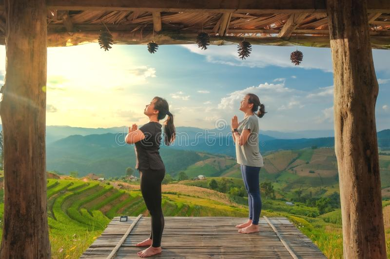 Healthy woman lifestyle balanced practicing meditate and zen energy yoga outdoors on the bridge in morning the mountain nature. stock photos