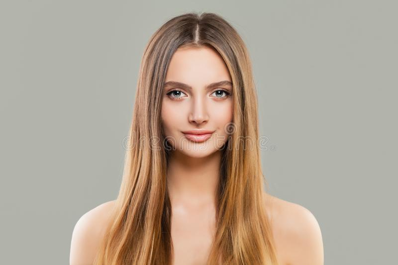 Healthy woman portrait. Beautiful model with clear skin and long shiny brown hair royalty free stock photography