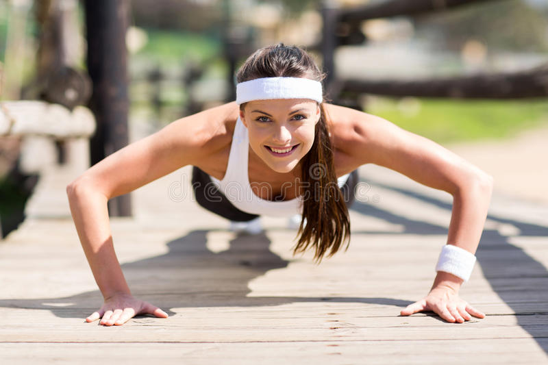 Healthy woman pushups royalty free stock image