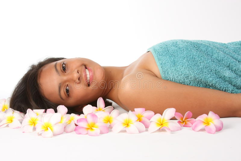 Healthy Woman In Spa Amongst Frangipani Flowers Royalty Free Stock Photos