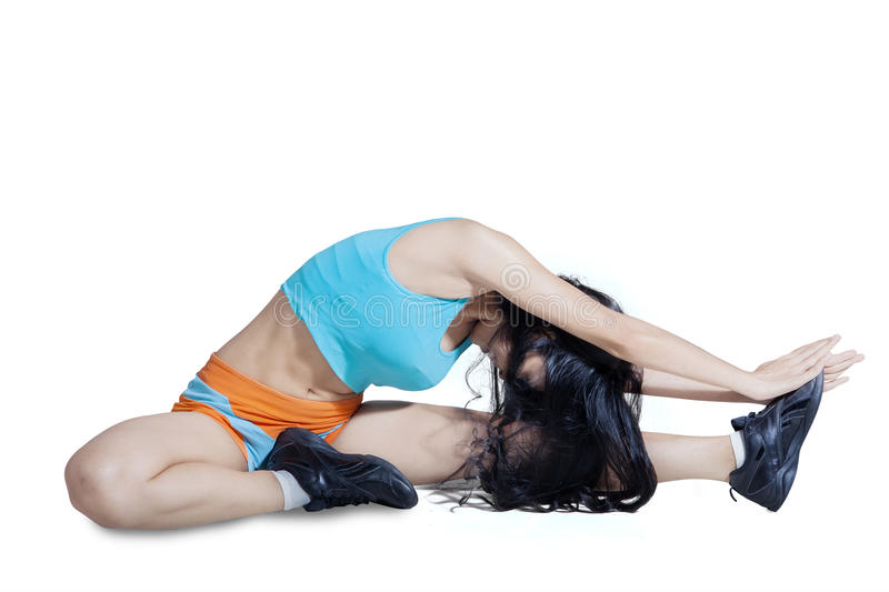 Healthy woman stretching her body stock photo