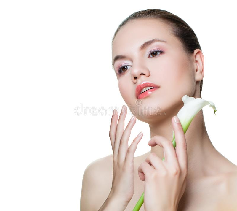 Healthy woman with white flower isolated on white background. Female model face. Cosmetology, beauty, skincare and spa concept royalty free stock image