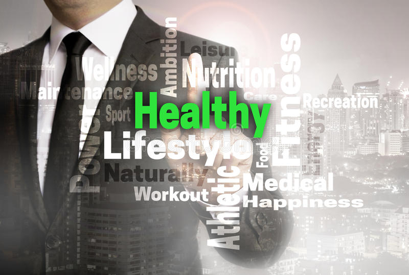 Healthy wordcloud touchscreen is shown by businessman.  stock photos