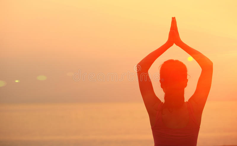 Healthy yoga woman meditation at sunrise seaside stock images