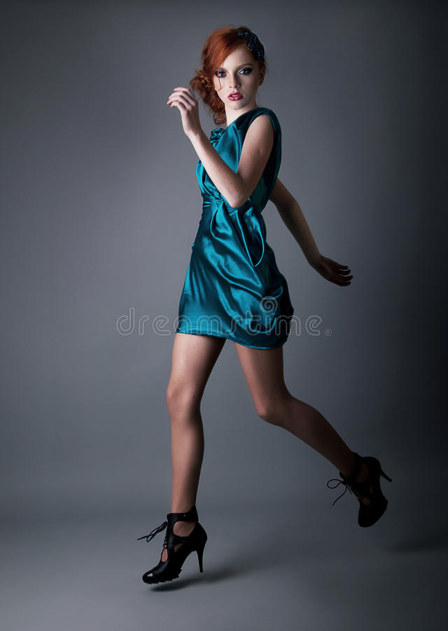 Healthy young active redhead fashion girl running royalty free stock photos