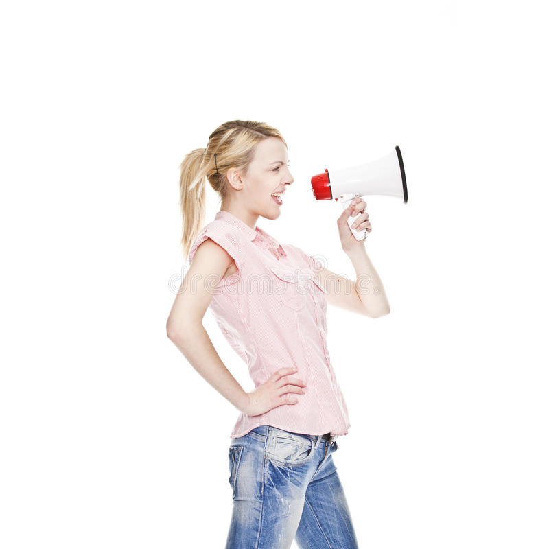 Healthy young attractive woman with loudhailer. Healthy young blonde attractive woman shouts in a bullhorn stock image