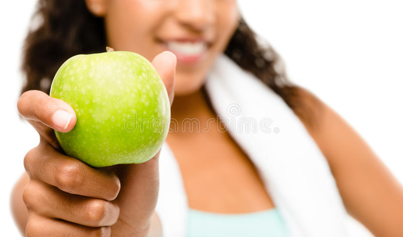 Healthy young mixed race woman holding green apple isolated on w royalty free stock photography